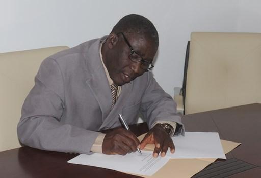 Rev. Musa Asake, General Secretary of the Christian Association of Nigeria, signing the declaration.