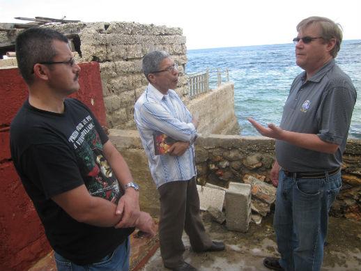 Russ Stendal, right, meets with FARC negotiators Yuri Camargo, left; and Noel Pérez, center.