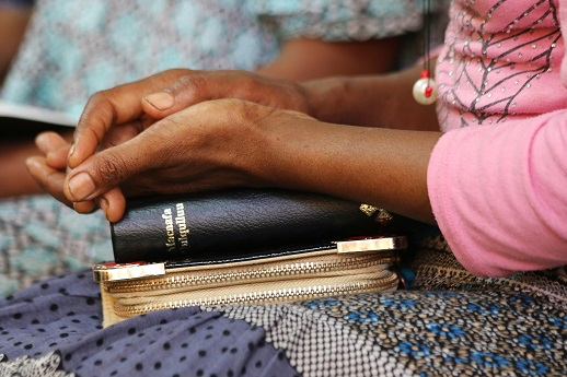 An Ethiopian woman with her Bible, 2016.
