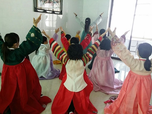 Women at a church group in China, 2016. Free from the constraints of living in North Korea, they often dress in traditional Korean clothes.