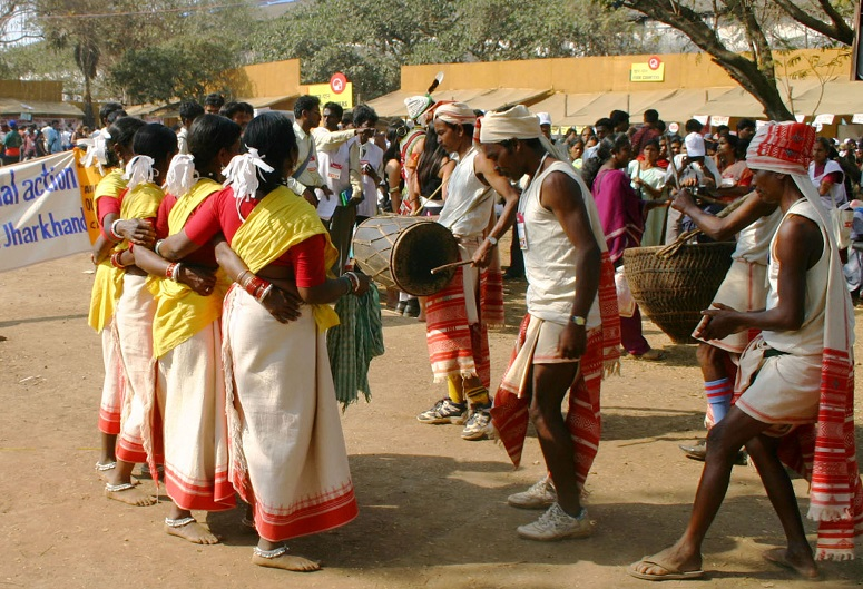 Tribal Christians dancing in traditional attire at a church convention
