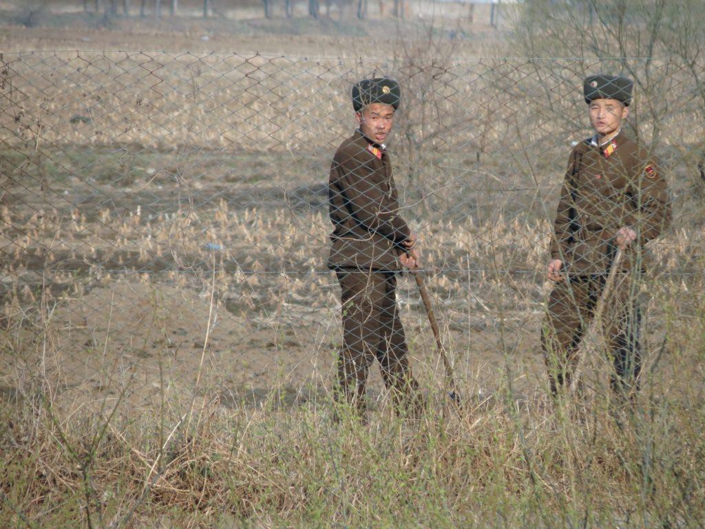 North Korean border guards on the banks of the Yalu Border River between China and North Korea.