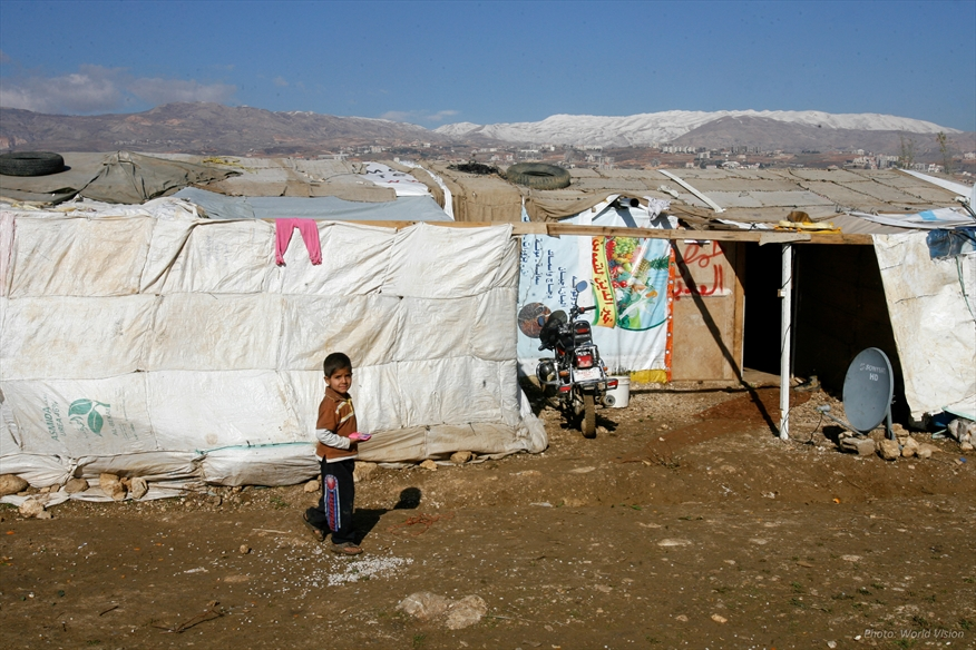 Boy outside a tent in a refugee camp in Lebanon. (Photo: World Vision)